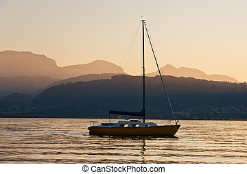 Solitary yacht on the lake in a sunset