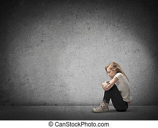 blonde girl alone sitting on the ground
