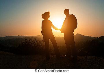 solnedgång, par