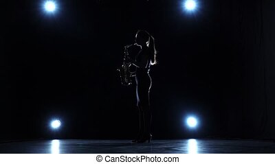 Solo concert of female playing on saxophone in slow motion -...