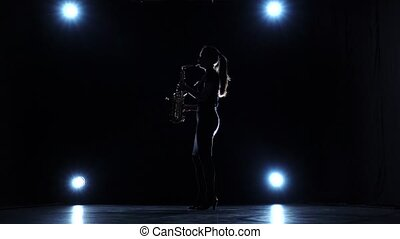 Solo concert of woman playing on saxophone in slow motion -...