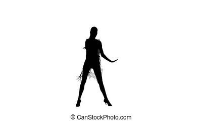 Solo girl is dancing elements of ballroom dancing. Silhouette, studio