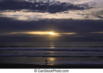 surfer at sunset
