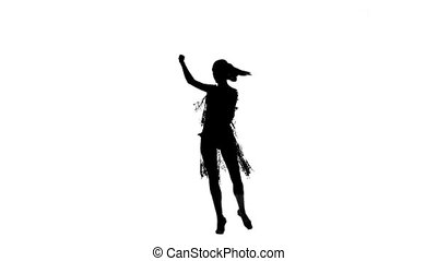 Solo woman dancing elements of ballroom dancing. Silhouette, slow motion