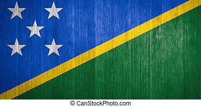Solomon Islands Flag on wood background