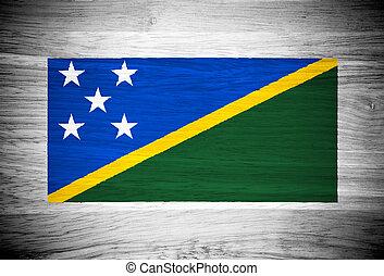 Solomon Islands flag on wood texture