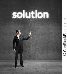 businessman standing on concrete room with solution