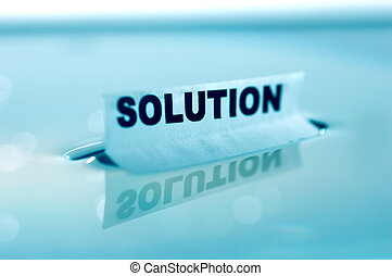 SOLUTION concept - Card floating on water surface with ...