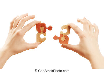 Solution - Human hands connecting two puzzle pieces together...