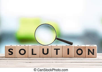 Solution search sign with wooden cubes