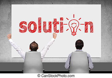 solution - two businessman looking on poster with drawing...