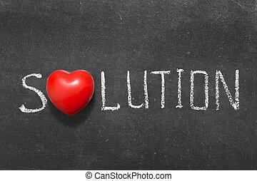 solution word handwritten on blackboard with heart symbol...