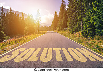 Solution written on road in the mountains. Solution text on the road.