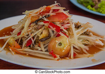 Som Tam is spicy green papaya salad Thai food.