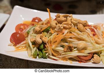 Som Tum, Thai papaya salad served on plate.
