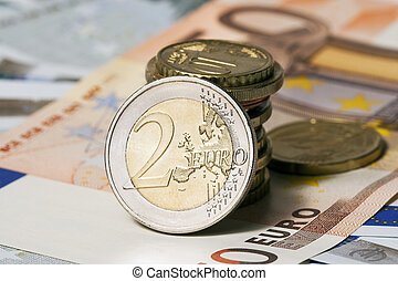 some banknotes on five and fifty euros and coins - The ...