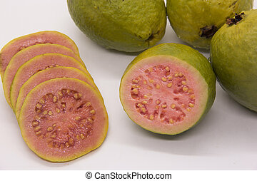 Some Brazilian guavas on white background. Tropical fruit.