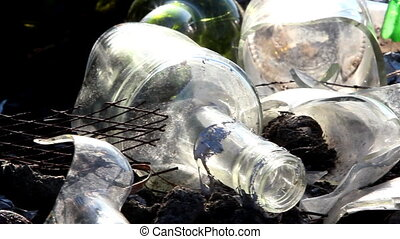 Some broken bottles on the garbage area