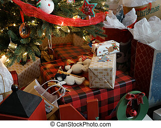 Christmas gifts piled under a Christmas Tree