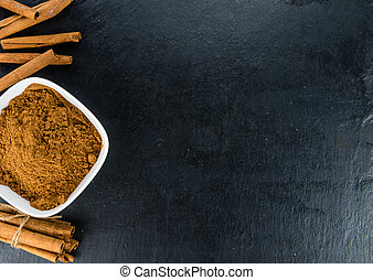 Some Cinnamon (ground) on a dark slate slab - Some Cinnamon...