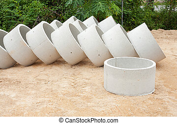 Some concrete tubes in the ground