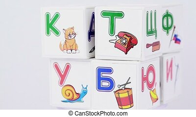 Some cubes with letters and images on it