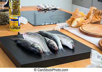 Some fishes on the kitchen's table