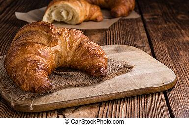 Croissants - Some fresh baked Croissants on vintage wooden ...