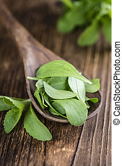 Some fresh Stevia leaves (selective focus) on a vintage...