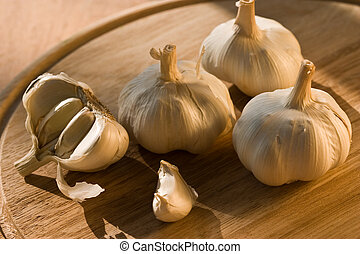 garlic - some garlic and chive garlic on the wooden board