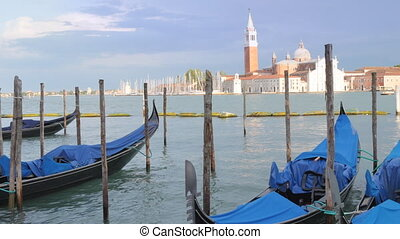 Some gondola waiting in Venice - Some empty gondolas in...