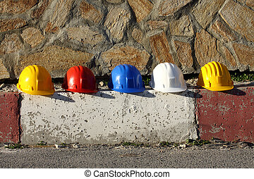 Some helmets close up on work place