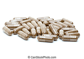 Some homeopathic brown pills isolated on the white...
