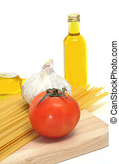 some ingredients of italian cuisine, like pasta, olive oil or tomato