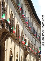 Italian flags outside of a windows