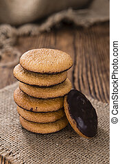 Some Jaffa Cakes (close-up shot) on rustic wooden background