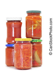preserved tomato - some jars of preserved tomato isolated on...