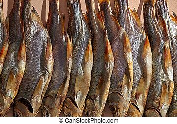 Some jerky or dried salty taranka, tasty clipfish on pink ...