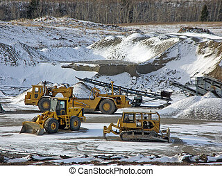 some machines in a gravel pit
