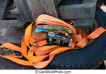 some orange straps to security the load on the car