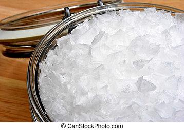 some organic sea salt flakes in a jar