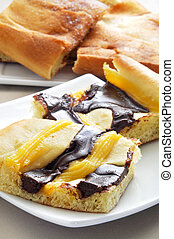 some plates with different types of coca, typical catalan sweet flat cake, such as coca de crema or coca de sucre