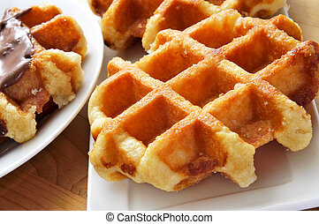 waffles - some plates with waffles on a wooden table