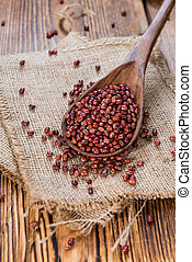 Some Red Beans (close-up shot) on rustic wooden background