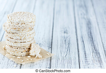 Some Rice Cakes on an old wooden background (detailed close-...
