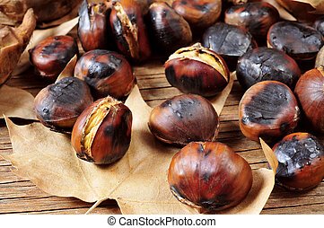 roasted chestnuts - some roasted chestnuts and autumn leaves...