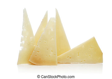 manchego cheese - some slices of manchego cheese on a white...