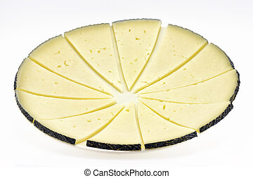 some slices of manchego cheese, typical of Spain, isolated...