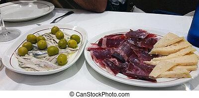 some spanish tapas such as serrano ham