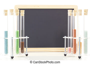 Some test tubes in front of blank blackboard
